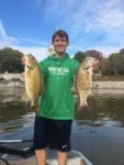 Drew Sallada of Hurricane, W.Va. with a couple of winter time smallmouth caught on the Kanawha River near the State Capitol.