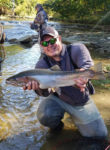 Joe Bragg of Westover, W.Va. with a fall steelhead caught on a tributary of Lake Erie on a fly rod and a streamer patterned after bait fish.