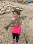 Five-year old Kenleigh Robinson of New Martinsville, W.Va. shows off a nice sauuger she caught at the hydro dam in New Martinsville.
