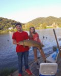 Kyra Duffield of East Bank, W.Va. with a sizeable carp she caught while fishing on the Kanawha River near her hometown of East Bank.