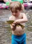 Ledger Johnson, age 3, of Arthurdale, W.Va. is mighty fascinated and proud of this small mouth he caught on the South Branch of the Potomac River.  It was the little guy's first fish!