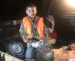 Levi Marshall, age 7 , of Harrison County, W.Va. proudly shows off his first buck killed in Lewis County during the 2019 buck hunting season.