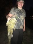 Lexi Marcum, age 13, of Chapmanville, W.Va. with her first ever mud cat.  Unknown where she caught it.