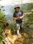 Michael Gordon of Hurricane, W.Va. with one of more than 30 rainbow trout he caught and released while camping with friends during a week in 2019 on the Cranberry River, about seven miles behind the locked gate. All caught on spinners