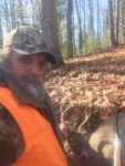 Rusty Lane of Marlinton, W.Va. with a four-point buck he killed on opening day while hunting in the Monongahela National Forest in Pocahontas County, W.Va.