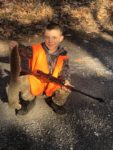 Micah Ertel, Age 9, of Petersburg with his first squirrel killed in Grant County,W.Va. with his Henry Lever Action 22.