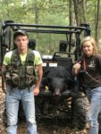 Tiffany Warner, 16, of Riverton, West Virginia with a 225 lb. black bear killed during the early bear season in 2019.