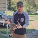 Todd Taylor of Alexandria, Va. with a buck he killed while bowhunting in Marion County, W.Va.