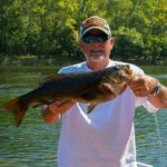 Tom Moses of Bluefield, Va. with a New River smallmouth he caught in the heat of an August day.
