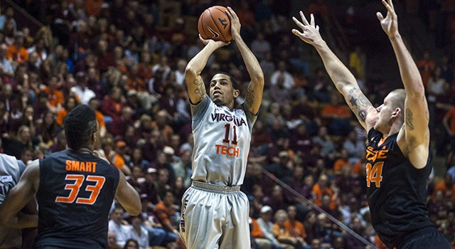 Dec 1, 2012; Blacksburg, VA, USA; Virginia Tech Hokies guard Erick Green (11) shoots the ball over Oklahoma State Cowboys center Philip Jurick (44) and guard Marcus Smart (33) during the second half at Cassell Coliseum. Mandatory Credit: