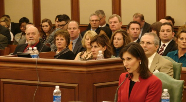 NTSB Chairman Debbie Hersman testifies before a Congressional field hearing of the Senate Commerce Committee while victim Sue Bonham and others listen in Charleston.