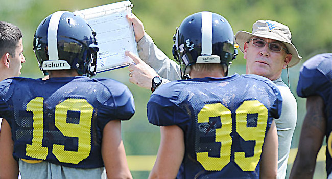 Steve Dunlap, who spent two stints at WVU covering 22 seasons, was dismissed from Dana Holgorsen's staff Saturday.