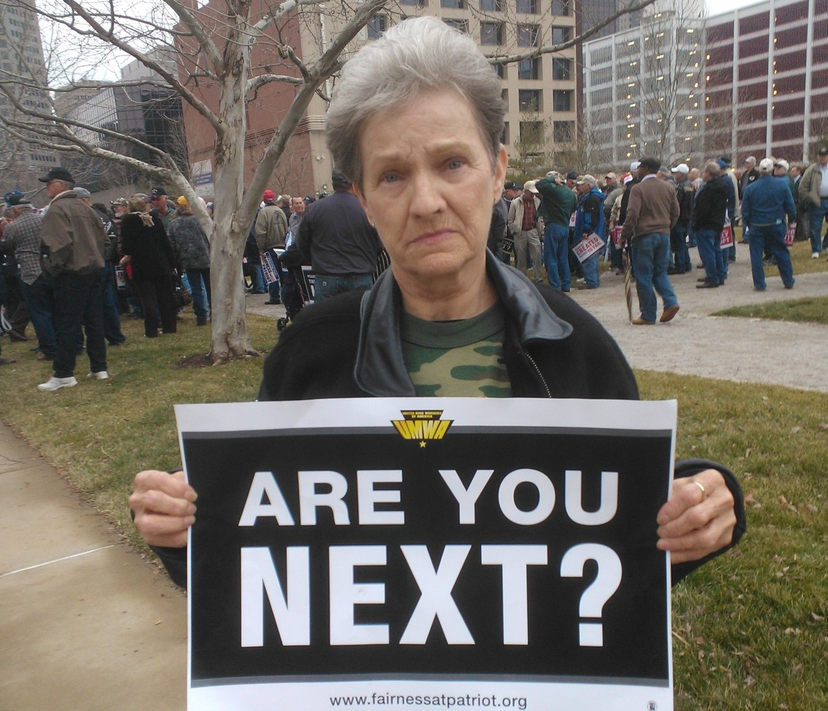 Shirley Inman of Madison, WV protests in St. Louis, fearful her cancer will return and she'll have no promised health care coverage to pay for it