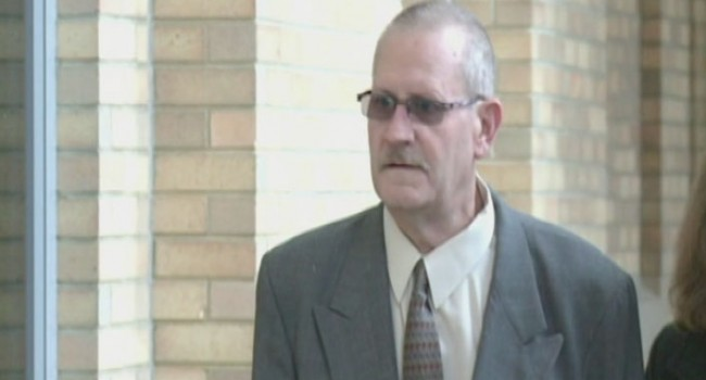 David Hughart, seen here before his Feb. 2013 plea hearing, was sentenced to 42 months in federal prison.