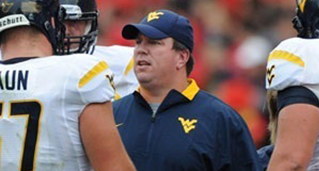 Oklahoma officially announced the hiring of West Virginia offensive line coach Bill Bedenbaugh on Sunday.