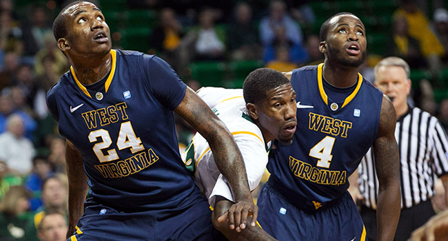 West Virginia center Aaric Murray battles Baylor's A.J. Walton for a rebound in Waco on Wednesday night, where the Mountaineers fell 80-60.