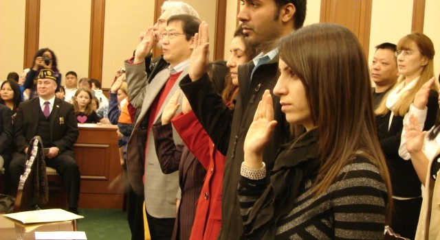U.S. Citizenship and Immigration Services says even though its changes the services of its Charleston offices it will continue to hold naturalization ceremonies in Charleston like this one in Feb. 2013.