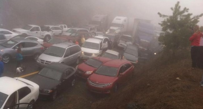 Dozens of vehicles piled up in the fog Sunday along I-77 in Fancy Gap
