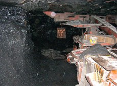 Victim was running a roof bolting machine like this one and putting a bolt into the mine rib (wall) when the rock fell from above.