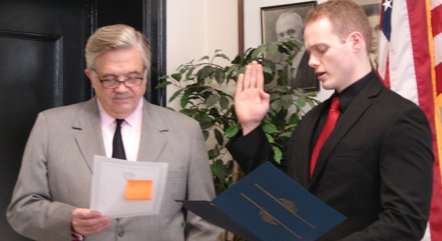 Charleston Mayor Danny Jones swears in new Charleston police officer Kevin Day during a Thursday ceremony.