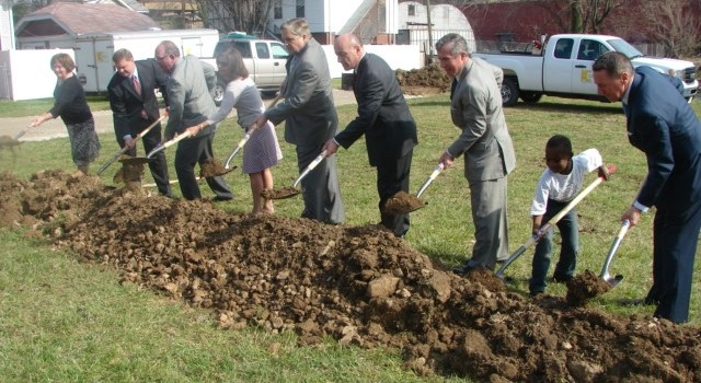 Charleston Mayor Danny Jones (fifth from left) among those who took part in Monday's groundbreaking near Laidley Field.