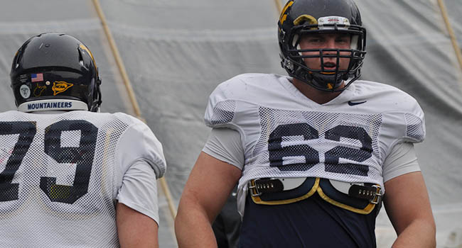 West Virginia's Nick Kindler (79) and Curtis Feigt (62) are roommates competing for the starting job at right tackle.