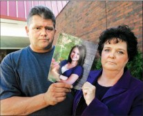 Dave and Mary Neese of Morgantown displayed a photo of their daughter Skylar, who went missing last summer. Her remains were found in January just a few miles across the Pennsylvania border.