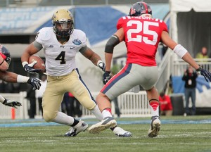 """Former Pitt running back Rushel Shell arrived at West Virginia last August overweight. But assistant JaJuan Seider says Shell """"firmed up"""" while sitting out the season."""