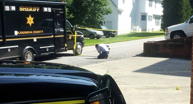 Deputies look for clues at Kanawha County murder scene.