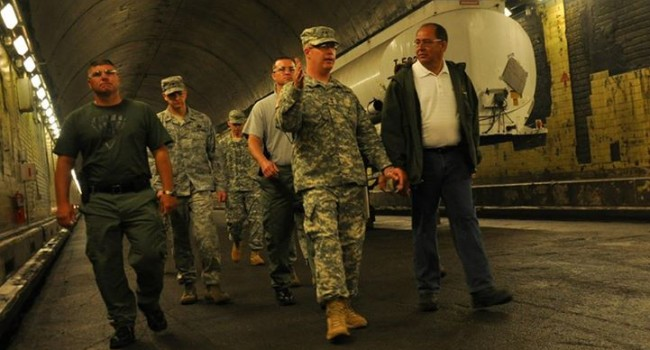 WV Adjutant General James Hoyer shows Gov. Earl Ray Tomblin a nationally recognized training facility (Memorial Tunnel) in West Virginia.