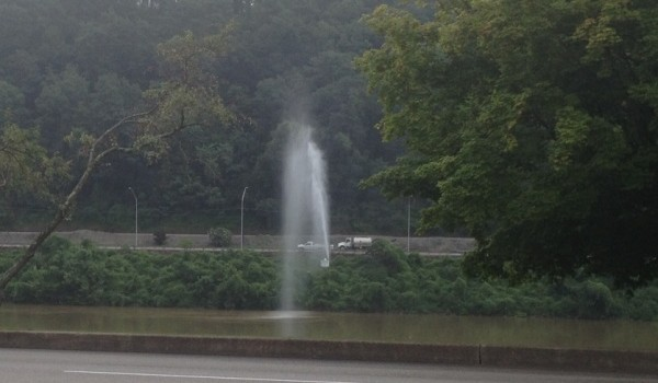 A geyser pours from a broken valve connection in a main line spur along Charleston's MacCorkle Avenue, seen here from across the Kanawha River on Kanawha Blvd.