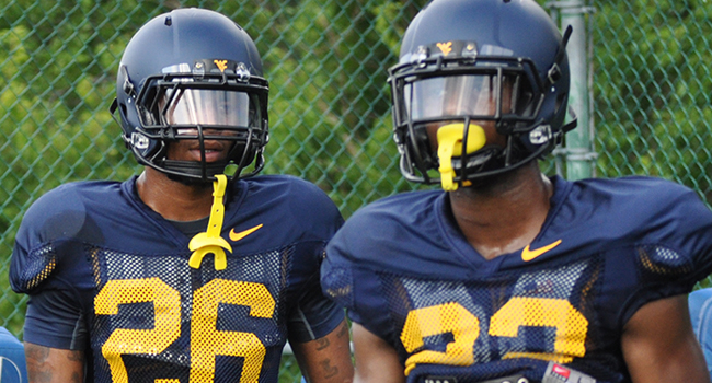 WVU junior cornerback Travis Bell (26) is currently working with the first-team defense, while fifth-year senior Brodrick Jenkins (23) is on the second unit.