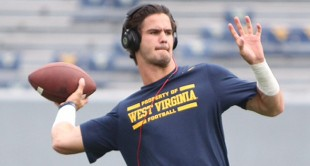 WVU's Clint Trickett warms up before Saturday's opener against William & Mary.