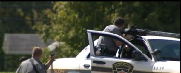 Pennsylvania State Police surrounded a house in North Union Township Friday where a West Virginia man and woman were holed up inside.