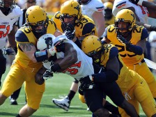 Jared Barber (33), Kyle Rose (93) and Will Clarke (98) take down Oklahoma State running back Jeremy Smith, who managed 1 yard on 15 carries