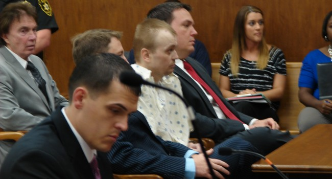 A special prosecutor will now be appointed to prosecute murder charges against Mingo County resident Tennis Maynard (center).