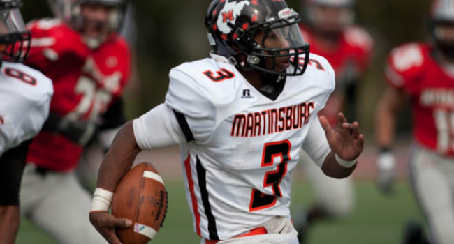 Former Martinsburg quarterback Cookie Clinton is accused of taking $2,000 and other items from the school.