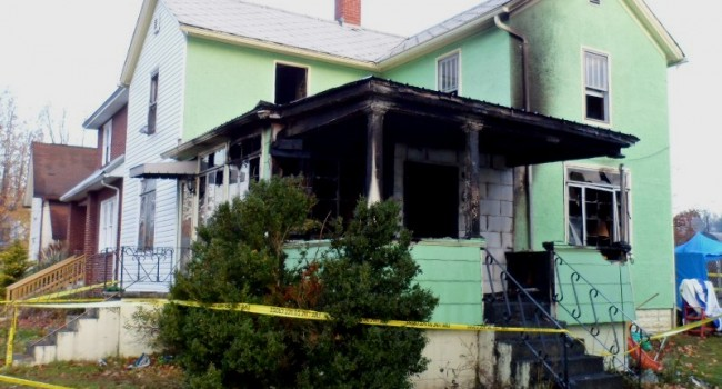 The home on Central Street in Elkins where a fire claimed six lives.