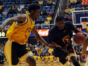 West Virginia forward Jonathan Holton, who had 11 points and 15 rebounds during the Gold-and-Blue preseason scrimmage, won't be be allowed to play this season by NCAA.