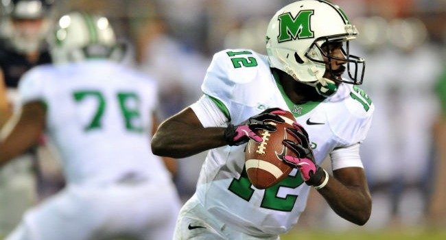 Thundering Herd quarterback Rakeem Cato (12) prepares to throw a pass against the Florida Atlantic Owls during the second half at FAU Football Stadium.
