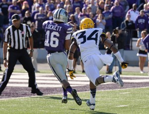 Kansas State receiver Tyler Lockett beat West Virginia cornerback Icky Banks on a 35-yard touchdown pass—one of three scores for Lockett in the 35-12 victory.