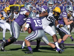 West Virginia defensive lineman Will Clarke (98) pressures Kansas State quarterback Jake Waters (15) during the first half at Bill Snyder Family Stadium.