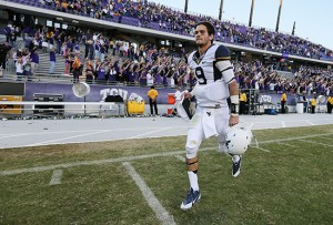 West Virginia quarterback Clint Trickettruns off the field after a 30-27 overtime victory at TCU on Nov. 2.