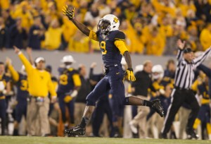 West Virginia's K.J. Dillon celebrates after forcing a Texas interception.