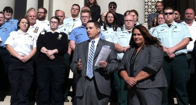 Emergency Medical Service workers call on Governor Tomblin to remove their non-emergency service from a cost cutting provision in Medicaid transports.