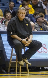 With his right hip ailing, WVU coach Bob Huggins used a sideline stool last season.