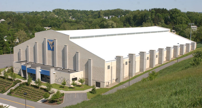 WVU's Caperton Indoor Facility opened in 1998 and had new turf installed in 2006 to more closely match the playing surface at Mountaineer Field.