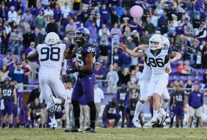West Virginia kicker Josh Lambert (86) celebrates after kicking the game winning field goal in overtime against the TCU Horned Frogs at Amon G. Carter Stadium.