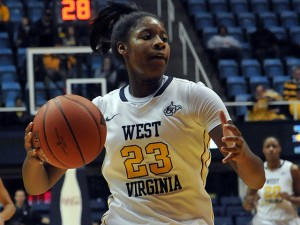 Bria Holmes scored 13 of her 16 points in the opening half as West Virginia downed Iowa State 67-56.