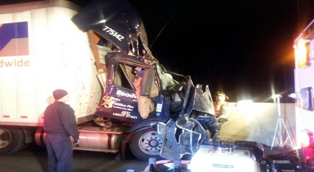 The wreckage of the Roadway truck cab after it struck the back end of another semi at a high rate of speed.